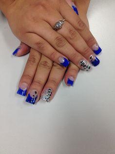 Royal blue nails with silver glitter and cheetah.