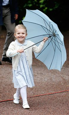 July 14, 2015....Sweden's Princess Estelle certainly stole the show with her mini umbrella during Princess Victoria's 38th birthday celebration on Tuesday. The adorable 3-year-old waved to the crowds as she joined her mom and dad Prince Daniel for the family celebrations.
