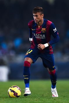 Neymar of FC Barcelona runs with the ball during the La Liga match between Real Sociedad de Futbol and FC Barcelona at Estadio Anoeta on January 4, 2015 in San Sebastian, Spain.