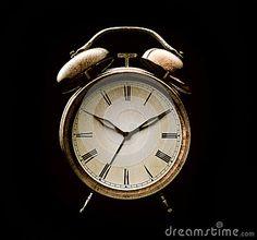 Old alarm clock isolated on black background