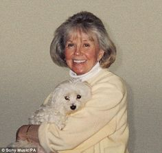 Doris Day, 87, poses with her pet dog Duffy to promote her first studio album in 17 years, My Heart.    What a beauty!