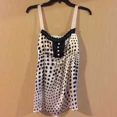 Silk polka dot tank 100% silk tank. Ribbon straps and tie back. Beaded detail. Fits size B/C cup. Size is technically a medium, but it fits like a small. Someone seriously needs this top. I bought it and it is too small for my bust, and it is absolutely adorable. From a small boutique in Milwaukee, WI. Tops Camisoles