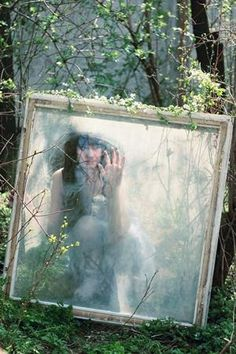 Gorgeous Conceptual Photography in Outdoors..... I dont normally like the photos with say the mirrors, but this concept is pretty neat! WOuld be neat to have the window in the air bewteen two trees and the model standing with her side to the window with hand on window.