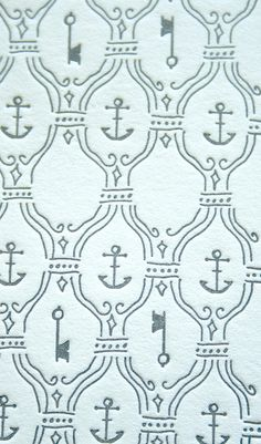 Close-up of the key and anchor pattern illustration on Colleen & Paul's letterpress wedding invitations.