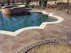 Stamped concrete pool deck - love the use of color and pattern