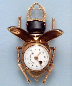 Watch in the form of a Stag Beetle, Swiss, Late 18th C   Verge gold and enamel with pearls and ruby eyes. Oh, the wings snap closed to hide the mechanism....