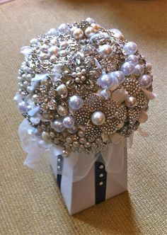How to Make a Brooch Bouquet. Make a lasting bouquet that does not require water. You can make and use jewelry flowers, book page flowers or fabric flowers for an unconventional and elegant look. A brooch bouquet is a stylish choice for a. Brooch Bouquet Tutorial, Broach Bouquet, Button Bouquet, Wedding Brooch Bouquets, Diy Bouquet, Crystal Bouquet, Bridesmaid Bouquet, Wedding Crafts, Diy Wedding