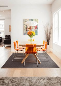 modern dining room with orange chairs, burnt orange, reddish-orange, tangerine orange, pantone autumn maple