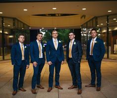 Grooms navy suits and gold ties !