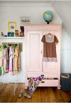 Same shade of pink I want to paint L's furniture. I also love the open closet on the side