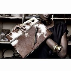 my brand. #bags #clutchbags #fashionaccessories #fashion #africanrenaissance #rebrandingafrica #cowhide #ownyourstyle #africanjewellery #metaljewelry www.adeledejak.com