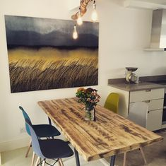 Marimekko Kuuskajaskari fabric, driftwood chandelier and rustic dining table