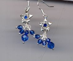 Delightful Silver Star Flower with Capri Breeze Accent Earrings by AGreenWoods on Etsy