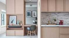 Interiors studio JAAK used custom cabinetry to convert an apartment in Hong Kong into an open-planned studio that takes its cues from Japanese homes