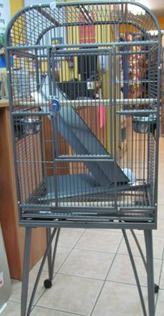 Great value for you money. This cage is suitable for Senegal, Quakers, Cockatiels and Conures.  Stands 58 inches tall  Dimensions 21 inches X 17 inches X 33 inches.  1/2 inch bar spacing.   Only available in colour as shown.