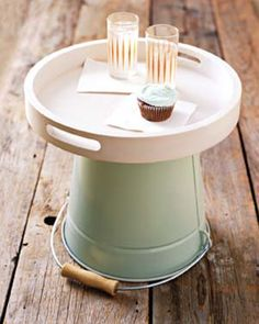 Use a bucket and tray to make a cute, portable outdoor side table.