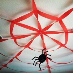 made this spider web out of #streamers for a #Spider-Man themed #birthday party!! even a good idea for a #halloween party, just use black streamers!! :D (very clever #party #decoration idea)