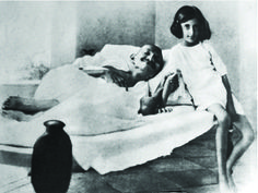 A famous #canvasprint photograph from her childhood shows Indira Gandhi sitting bedside of Mahatma Gandhi