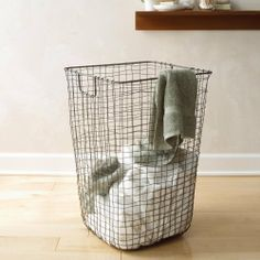 "Vintage Wire Hamper by Design Ideas. $139.99. Here's a fresh concept that has the appearance of time-tested authenticity. Made of weaved wire, this laundry hamper is both functional and nostalgic. Finished in a rust-proofing lacquer and suitable for years of use.  Features:  Made of hand woven wire Rust-proofing  lacquer finish Perfect for laundry or use as a tall storage basket Natural unfinished metal   Size: 25"" tall x 16 1/2"" square"