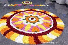 pookolam design- Celebrating Onam the Harvest festival of Kerala, India - This Hindu festival is famous for Bahubali, pookolams, boat racing , onam sadya & elephants. Come Explore India with us