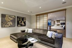 Shoji screen-styled sliding doors seperate the living room with the family area