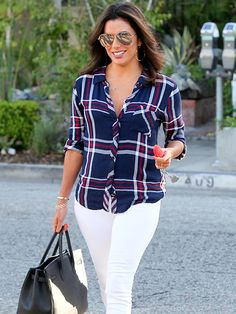 Eva Longoria made plaid look oh-so-fab, pairing a button-down in the coveted pattern with white jeans and aviators with gold flash lenses!