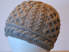 Ravelry: Honeycomb & Cruller Cable Hat pattern by Deborah Lawless
