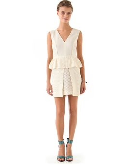 Tibi Tess Jacquard Peplum Dress ($575): Wear winter white with a trendy peplum waist. Pair with accessories in our favorite holiday color: teal