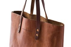 A solidly built tote bag is an everyday staple. Day, night, travel, errands - the Whipping Post Vintage Tote bag embodies utility. We've used vegetable tanned leather and included an interior poc Cheap Purses, Cheap Handbags, Cute Purses, Luxury Handbags, Tote Handbags, Purses And Handbags, Leather Handbags, Popular Handbags, Leather Bags