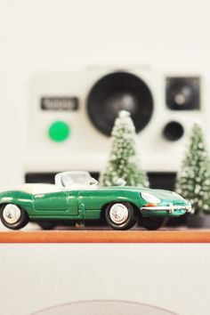 Green Convertible Car Die Set Table Decor on Top of Brown Table