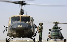 Both hubby's helicopters: UH-1 Huey & the Mi-17. In one picture! (I know they're both Iraqi in this shot, but still!)