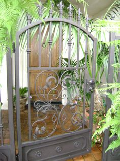 Arched Wrought Iron Courtyard Entry Gate With Scrolled