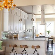 two bars/ 1 island / countertops / bar stools / Contemporary Kitchen by Ashley Campbell Interior Design