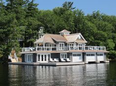 This is a beautiful boathouse on Muskoka Lakes, Ontario, Canada. When I was younger I would always look forward to going up to the cottage. When I was up there I would look at all the other big cottages. Luxury Cottages, Water House, Boat House, Houses On The Water, Lakeside Living, Lakeside Cottage, Style Deco, Cottage Exterior, Minimalist Home