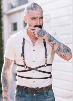 Our leather accessories are taking a bit of a bondage edge. Marrying a bit of punk back to our classic Americana - leather - Antique brass hardware strap One size fits all Sheehan & Co. menswear is all Made in USA Sock Suspenders, Leather Suspenders, Leather Harness, Leather Men, Brown Leather, Daniel Sheehan, Mens Leather Accessories, Komplette Outfits, Unisex Outfits