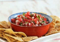 Ready in five minutes and no cooking required. Bright and juicy, this is The Very Best Fresh Tomato Salsa ever. Perfect for summer and tailgating season.