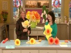 Martha Stewart and Morgan Levine fold giant daffodils from color craft paper and fabritac glue.