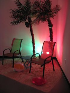 Laua chairs, palm trees and uplighting for a laua.  We rent all of these.