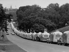 Airstream Travel Trailers wait in a long line of traffic to get a spot in a campground. Travel Trailer Guide by Asher Socrates, Photographic print available. #art #photography #trailers #camping #airstream