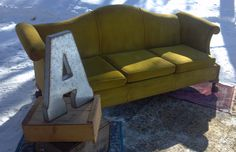 """Galvanized tin """"A"""" with vintage crates, rugs and velvet couch 