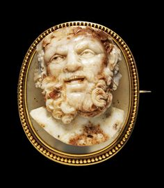Large oval cameo, sardonyx in two layers, brown mottled ivory on translucent grey ground, showing the face of a satyr. Probably Rome, 2nd half of the 17th century.