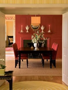 Specifically, the living room, dining room and entry way. Choose a color scheme for those areas first, then pull one color from the scheme. For example, take the red sofa and tone it down (say, to burgundy) for an accent in more private spaces such as the den, office or bedroom.