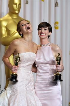 "2013 Oscars – Jennifer Lawrence, Best Actress winner for ""Silver Lining's Playbook,"" enjoys a laugh with fellow Oscar winner Anne Hathaway, Best Supporting Actress for ""Les Miserables."""