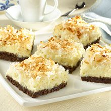 Coconut Cheesecake Bars!  The layers of flavor start with a crisp chocolate cookie crust, creamy coconut cheesecake, thanks to Coco GOYA® Cream of Coconut, and chewy toasted coconut.  Easy and delicious, these cheesecake bars are a definite crowd pleaser!