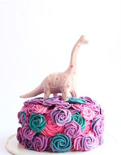 This could be the cutest girlie dino cake I have ever seen. It would be so fun for any girl's dino-themed birthday party no matter what age. Dino Cake, Dinosaur Cake, Dinosaur Party, Elmo Party, Mickey Party, Girl Dinosaur Birthday, Girls Party, Rosalie, 4th Birthday Parties