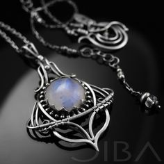 Saimin  An intricate, transparent, sterling silver necklace with a beautiful moonstone with intense blue fire. Entirely hand made, using the wire-wrapping technique.