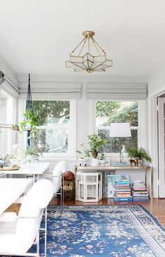 Emily Henderson - her home - blue area rug, white furniture, star chandelier, plants