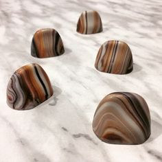 Tiger's Eye gemstone OPALYS bonbons. Tones of ivory, grey, black and bronze   By Pastry Chef & Chocolatier David H. Chow.