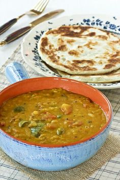 Dhal Curry - a very mild and nutritious curry made up mainly of lentils, tomatoes, chilies, and spices. Great with rotis.