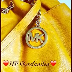 "HP MK Chain Tote, Yellow Leather MK Chain Tote, Yellow Leather  Approx dimensions 16x12 Strap drop 9"" Soft leather  Bag shows some wear with darker and lighter marks on the bottom but not really noticeable.  Good condition, smoke free.  No rips or tears. Michael Kors Bags Totes"